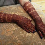 Filling bridal mehndi designs