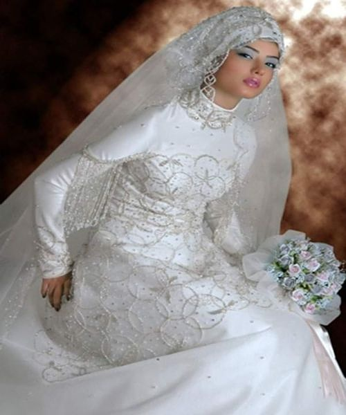 Modest wedding gowns for muslims wedding gowns 2013 for Wedding dresses for muslim brides