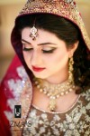 Pakitstani bridal makeup in red color