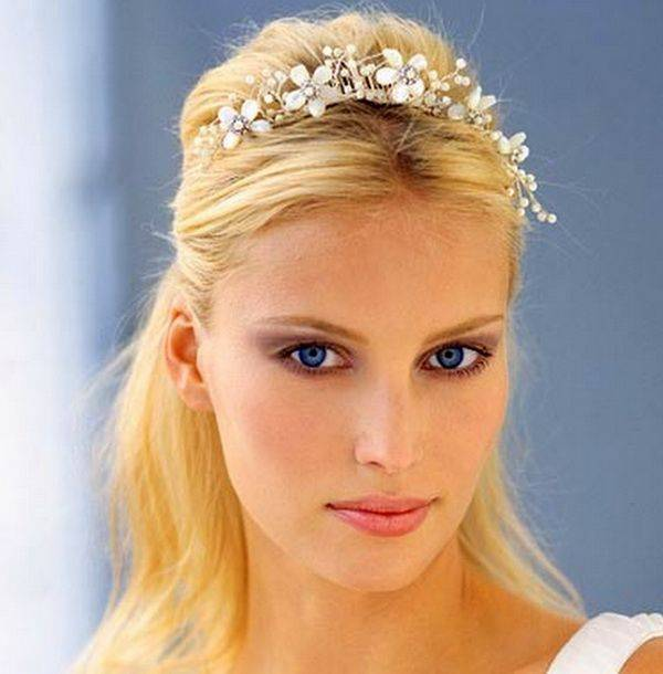 Back tied open hairstyle with floral headpiece