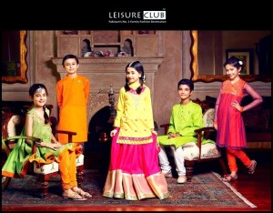Kids of these days are quite touchy about their looks. So for all such kids we are sharing Kids Eid Dresses 2014. There are many brands working on kids dresses these days and one the most prominent brand among them is Leisure Club. They are working since 1997 and are producing both Western and Eastern dresses for boys and girls. Recently Leisure Club Latest Eid Collection 2014 has been launched which include some of the most stunning Eastern dresses of boys and girls. Lets have a look at the collection of we are sharing. Leisure Club Kids Eid Dress Collection 2014: Eid is one of the great religious occasions in Pakistan and for this special event Leisure club has unveiled their beautiful eid collection which consists of dresses of eastern kind for both teenage and young boys and girls. GIRLS COLLECTION: To be fashionable is a female's right so, girls are seemed to be more concern about their looks on every special occasion. Leisure club eid dresses for girls have all those characteristics that a young girl may want in her dresses.  The stuff they used for dresses is of different types like jamawar, chiffon and raw silk. The color combination they have used is the thing that makes their dresses a master piece. The collection include long shirts, frocks, shararas, open shirts and angrakha style dresses. They are beautifully adorned with embroidery, fancy laces and different ribbons.  BOYS COLLECTION: Now days boys do not remain behind from girls in fashion and trends. Their fashions are also changing and they want to keep their looks up to date. The kurta is the dress that boys love to wear on Eid occasion and keeping this thing in mind the brand has launched beautiful kurta designs for boys on this event. The kurtas are paired with pajamas that give a traditional look. The colors used are refreshing due to summer season like red, white, fresh green and blue. They are made formal with embroidery on the neckline and sleeves are both straight and with cuffs.